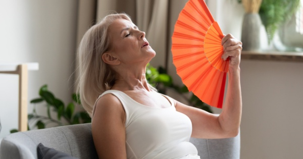 woman feeling hot in a conservatory with a poor conservatory roof 2
