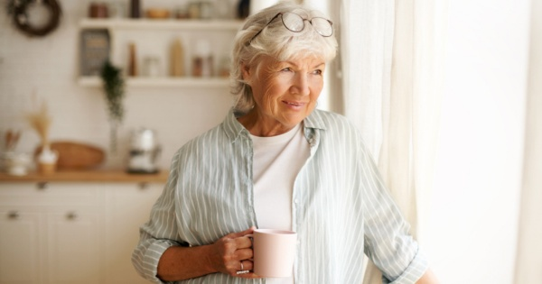 Mature woman thinking about conservatory roofing options