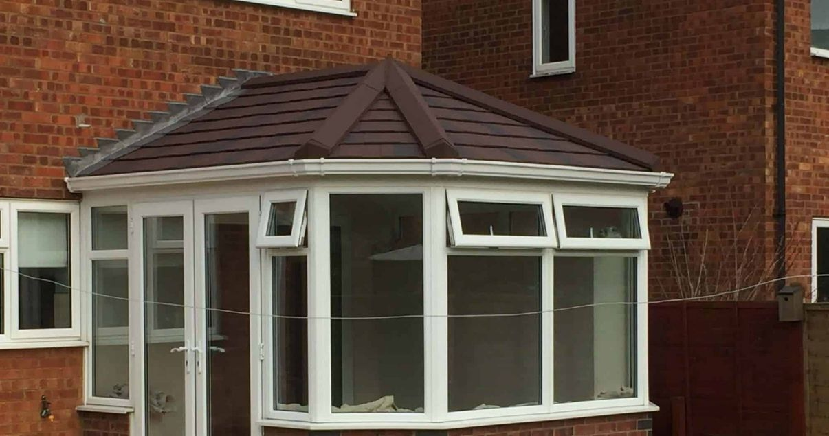 A victorian tiled conservatory roof avoids leaks and provides isolation against cold weather
