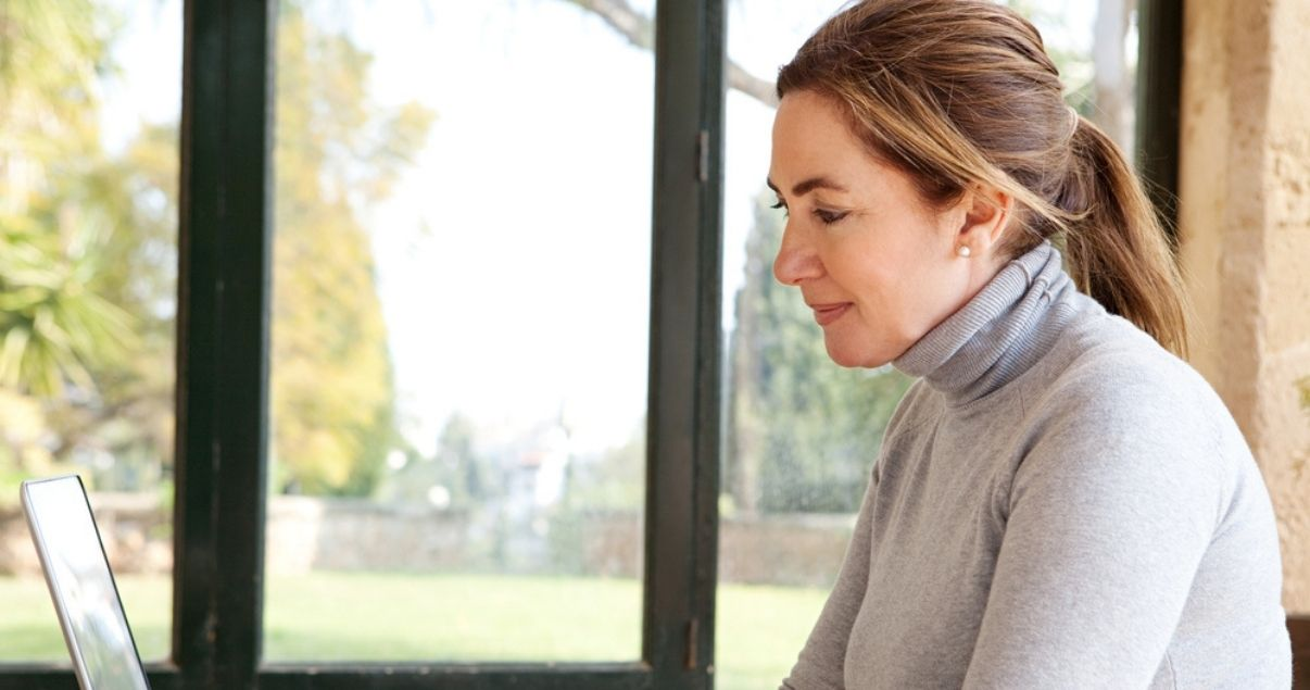 Woman choosing between a conservatory or extension for her home