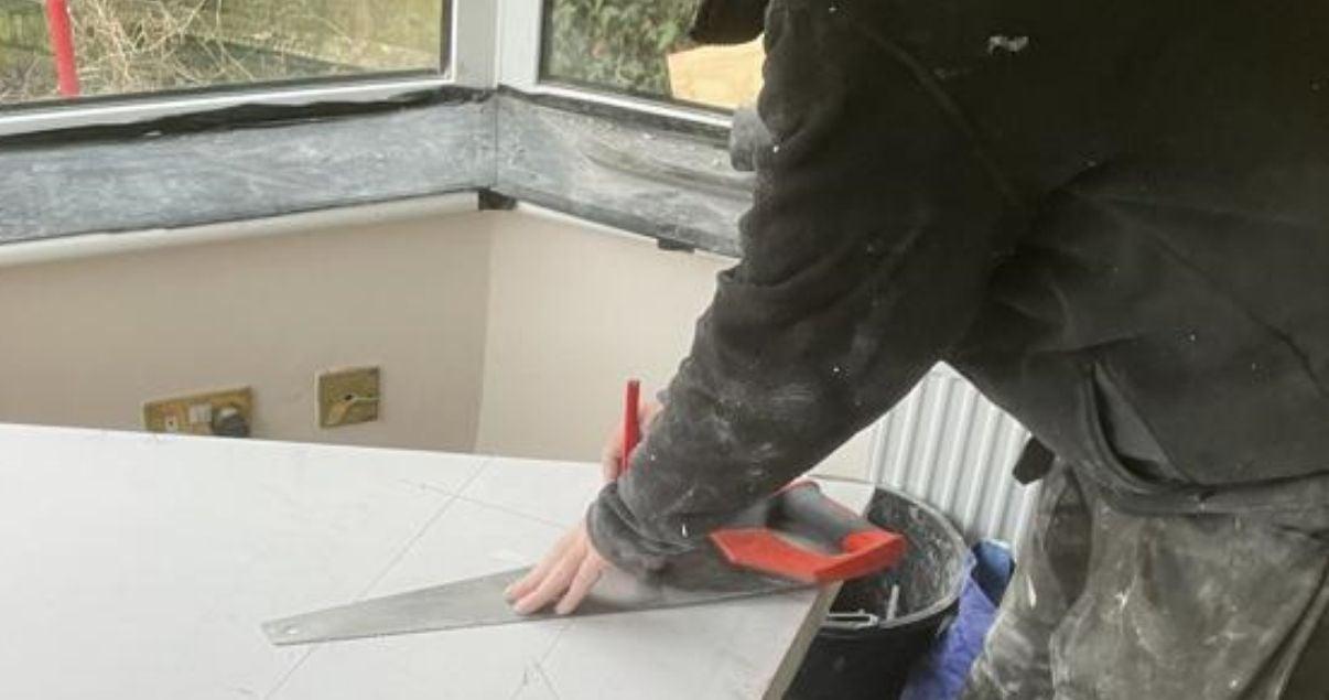 Conservatory roofing installer making measurements