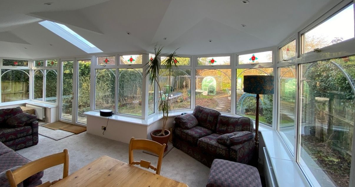 A conservatory living room can be achieved with a solid conservatory roof