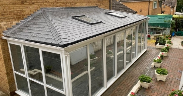 Final installed guardian warm roof conservatory upgrade with velux window installed.