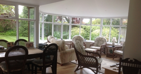 Converted conservatory opened up for open plan living with an insulated guardian warm roof installed by Projects 4 Roofing.