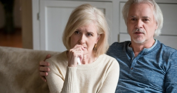 Worried couple because their polycarbonate conservatory roof is falling apart and they need to find a trusted solid roof conservatory installer.