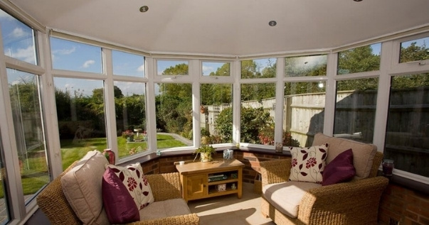 Family converts their conservatory into an insulated useful room by undergoing a conservatory roof conversion. (2)