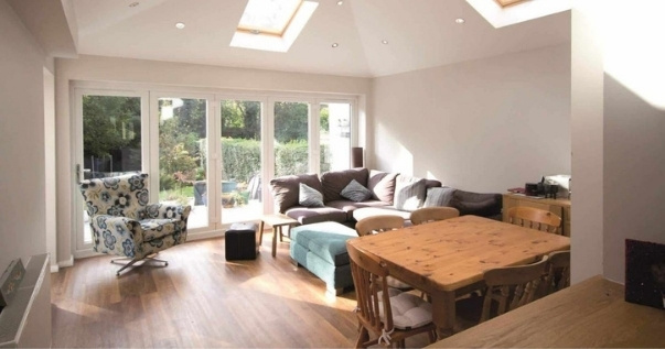 Family undergoes a conservatory conversion and joins their dining room and living room.
