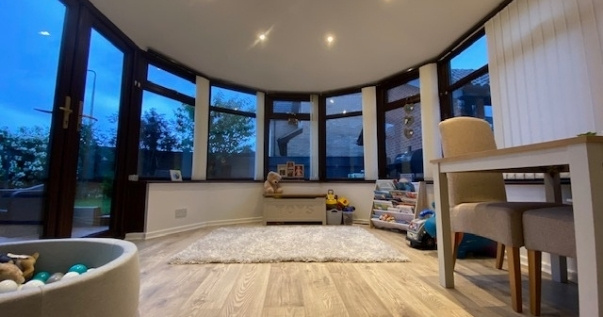 Family undergoes a conservatory conversion and joins their playroom and living room.