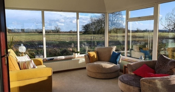 Family converts their conservatory into an insulated useful room by undergoing a conservatory roof conversion. (3)
