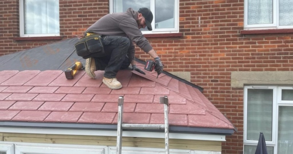 Family hires a qualified roofer to replace their polycarbonate conservatory roof to a guardian warm roof after having a leaking conservatory roof