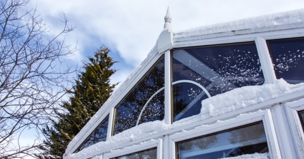 snow in a conservatory room without a warm roof to protect it