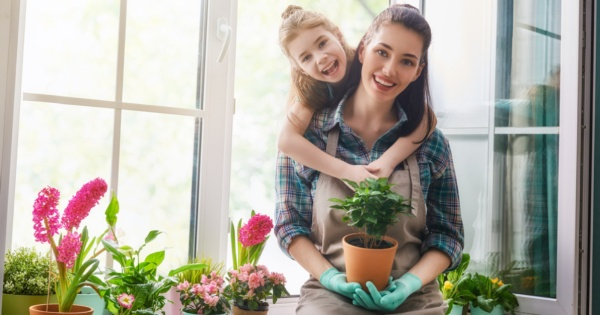 Mother and daughter in a conservatory garden room they got after a cheap extension