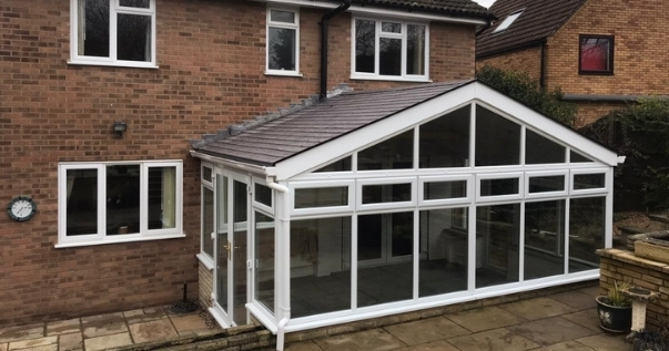 Family excited about their conservatory conversion with a Guardian Warm Roof.
